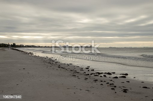 istock View of Fort Meyers in background during sunrise along beachfront on stormy morning along Fort Myers Beach, Florida. 1062947340
