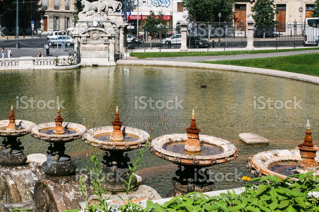 view of fountain and gate from Palais Longchamp stock photo