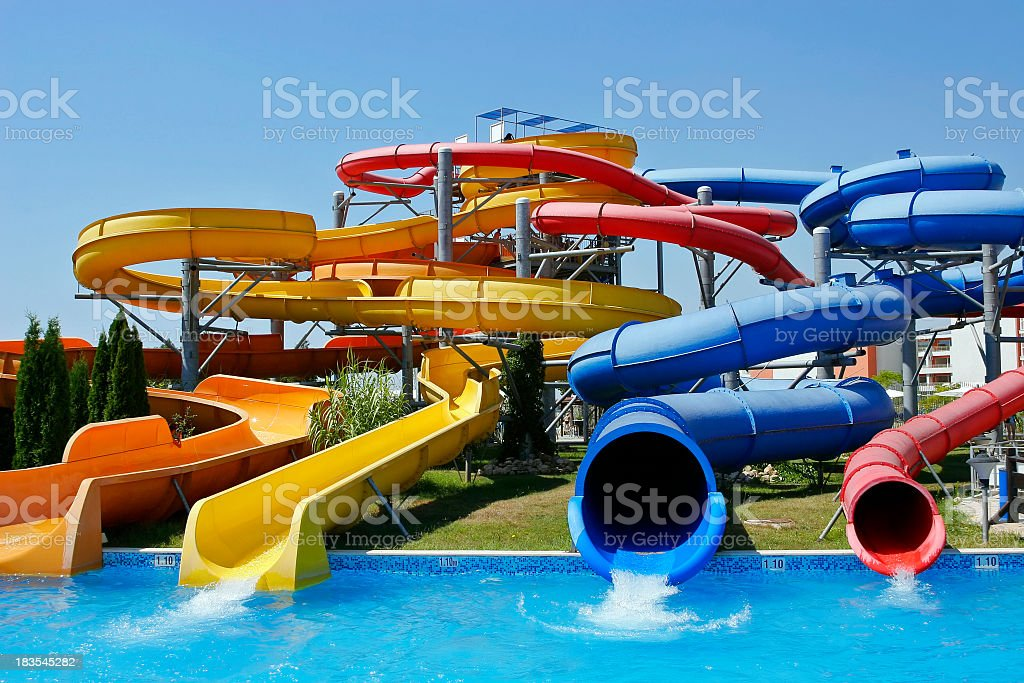View of four different water park tubes on a clear day  stock photo