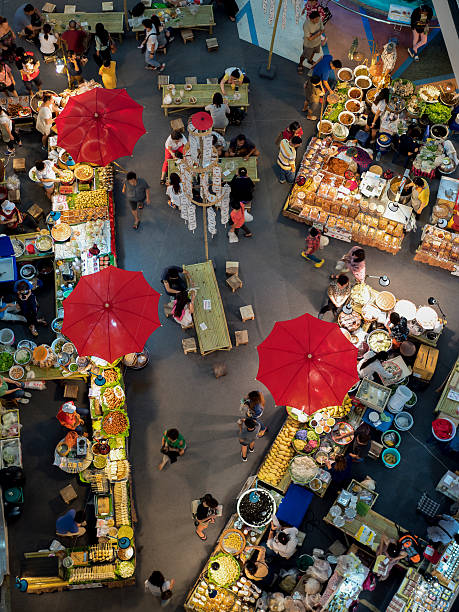 view of fresh fruit and vegetables market view of fresh fruit and vegetables market covered with umbrella in chiangmai , thailand. chiang mai province stock pictures, royalty-free photos & images