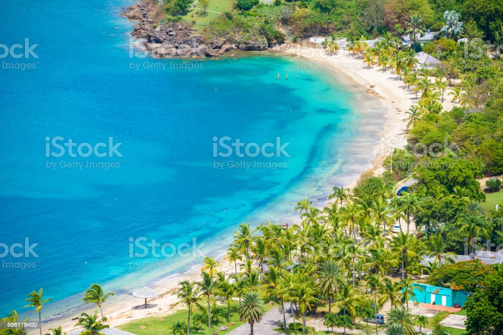 View of Galleon Beach from Shirley Heights, Antigua, paradise bay at tropical island in the Caribbean Sea stock photo