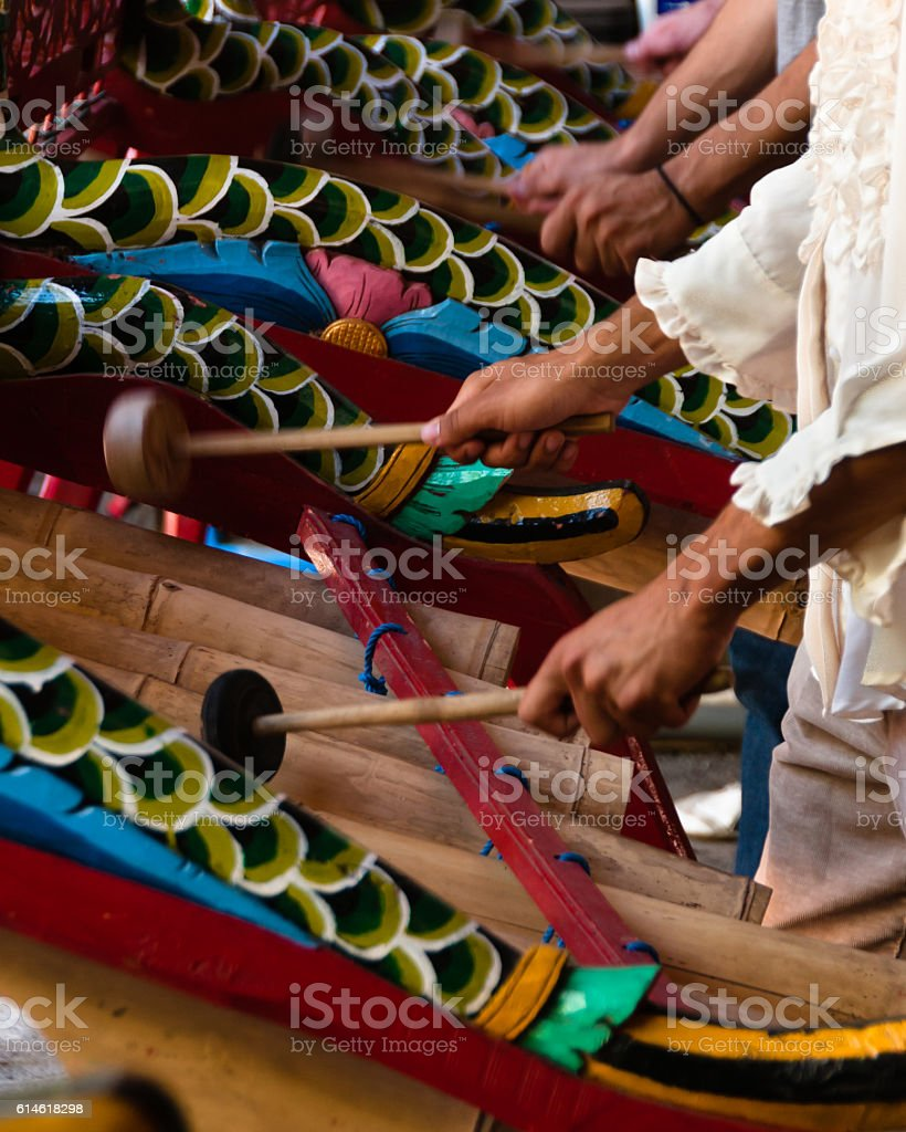 View of Gamelon musicians hands with traditional instruments. stock photo