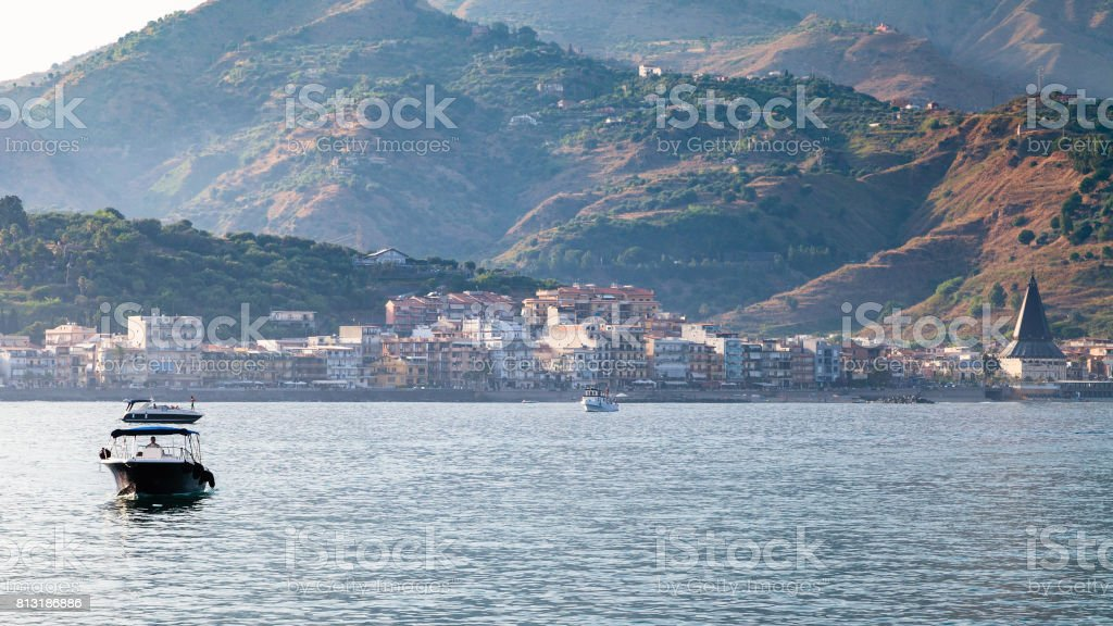 view of Giardini Naxos town in summer evening stock photo
