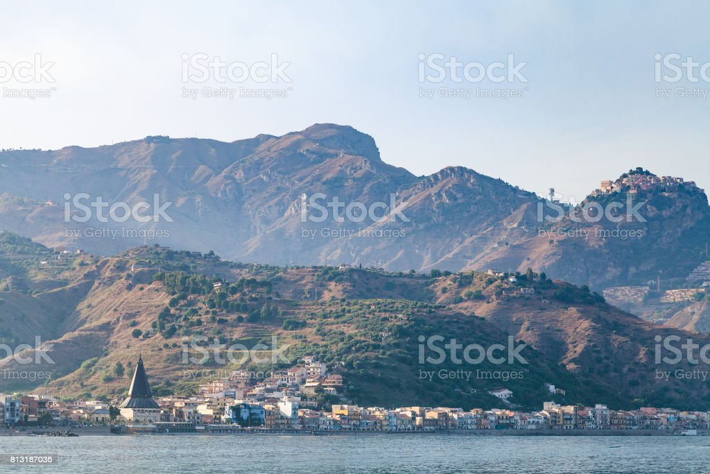 view of Giardini Naxos town in summer sunset stock photo