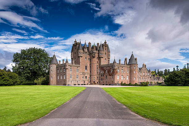 view of glamis castle in scotland, united kingdom. - castle stock photos and pictures