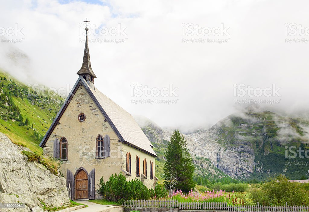 View of Gletsch Anglican Chapel and Rhone Glacier Valley stock photo