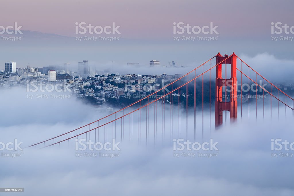 View of Golden Gate Bridge on a foggy day Golden Gate at dawn surrounded by fog Above Stock Photo