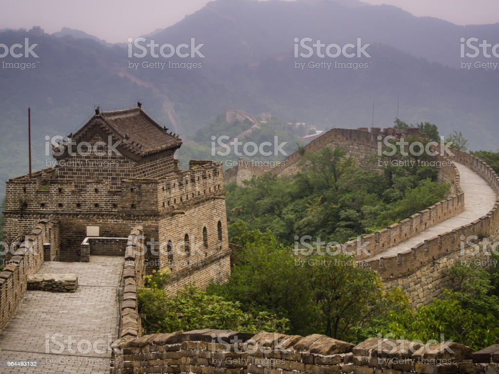 View of Great Wall at sunset in Mutianyu, Beijing. China. stock photo