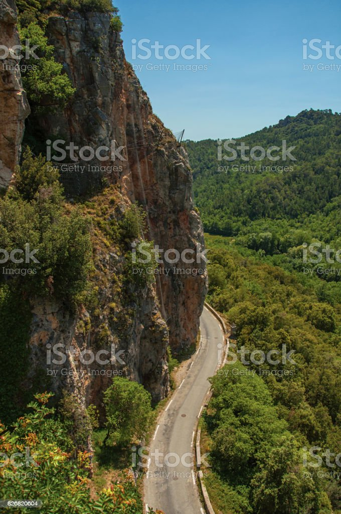 View of green valley and cliff, cut by road, near Châteaudouble stock photo