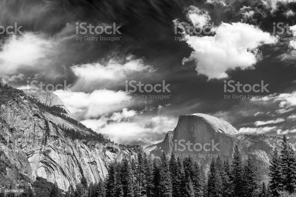 View of Half Dome with dramatic sky in Black and white, Yosemite...