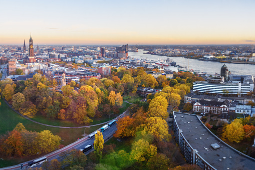View of Hamburg with Michel, harbor, and New Elbphilharmony on sunset. Germany