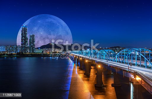 View of hanriver at Dongjak bridge and Full moon N Seoul tower at night in Seoul  south korea.