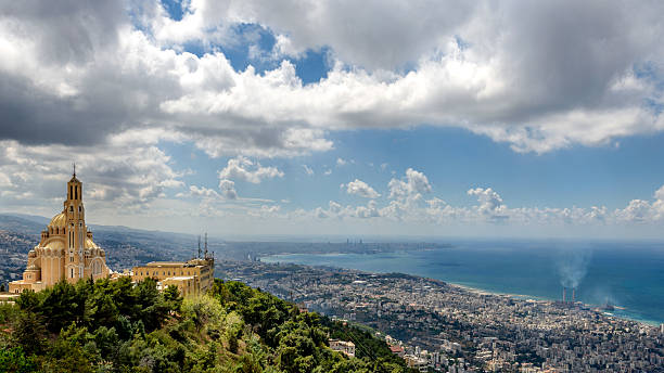 view of harissa monastery with beirut in the background - beirut foto e immagini stock