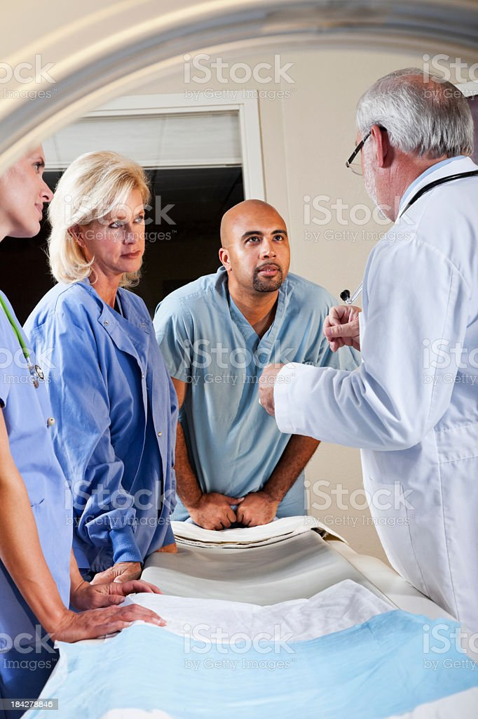 View of healthcare workers through CT scanner stock photo