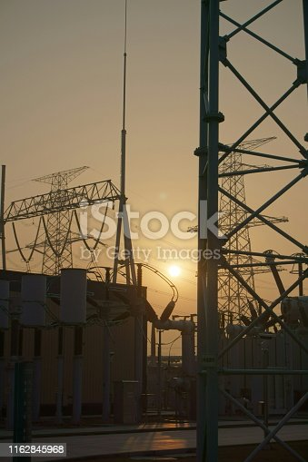 General view of a high voltage transmission substation in sunset