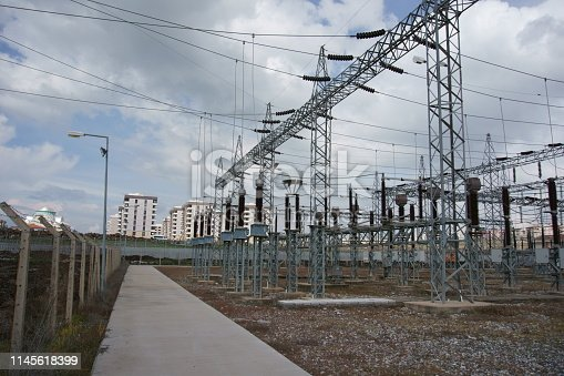 General view of a high voltage transmission substation from inside of security fence