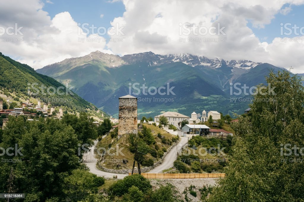 view of highway road and houses of small village with hills on background, Ushguli, svaneti, georgia stock photo