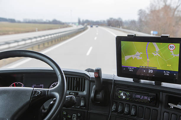 View of highway traffic from the truck View of highway traffic through the windshield of the truck cab. Navigation is mounted on the dashboard. global positioning system stock pictures, royalty-free photos & images