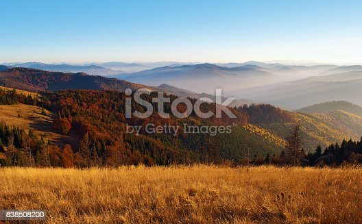 istock View of hills of a smoky mountain range covered in red, orange and yellow deciduous forest 838508200