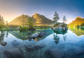 Mountain landscape and view of beautiful Hintersee lake in Berchtesgaden National Park, Upper Bavarian Alps, Germany, Europe. Beauty of nature concept background.