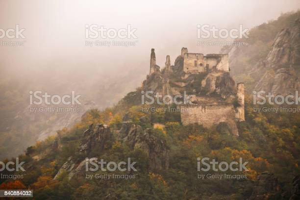 Photo of view of historic castle ruin, colorful autumn
