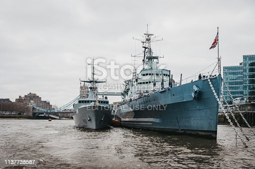 London, UK - March 16, 2019: View of HMS Belfast and another ship from River Thames. HMS Belfast most significant surviving Second World War Royal Navy warship that is now a museum moored in London.