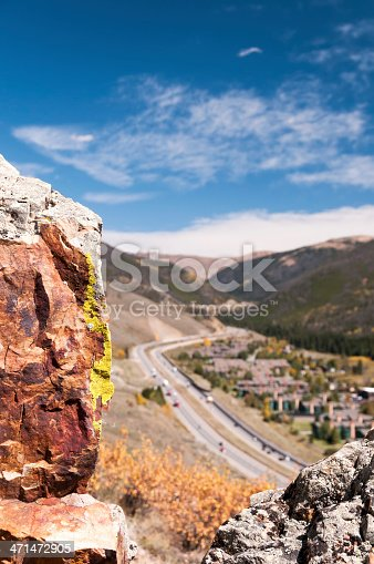 Lichen covered rocks frame a view of I70 as it climbs towards Loveland Pass and crosses the Continental Divide in the Eisenhower Tunnel in Summit County, Colorado.