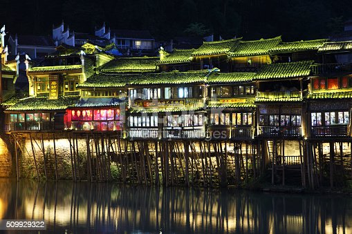 View of illuminated riverside houses in Fenghuang, China