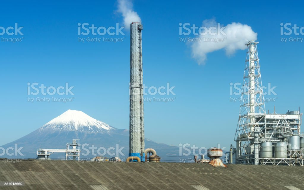 View of industrial district with Mt Fuji in background, Japan stock photo