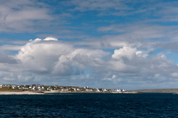 View of Inisheer from Doolin Ferry Looking west toward Inisheer as the Doolin Ferry approaches the dock at Caherard.  The island of Inishmann to the right.  Inisheer, Aran Islands, County Galway, Republic of Ireland michael stephen wills aran stock pictures, royalty-free photos & images