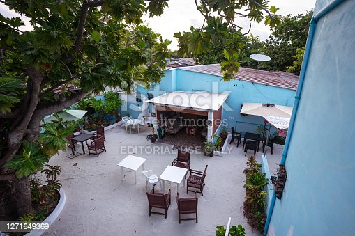 Bodufolhudhoo / Maldives - August 17, 2019: view of inner courtyard of cheap hostel for low budget tourists on local island of Maldives