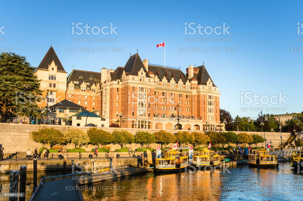 View of Inner Harbour Waterfront and Empress Hotel in Victoria at Sunset stock photo