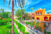 View of inner patio - Mercury Pond (Estanque de Mercurio) in the Royal Alcazar of Seville. Spain.