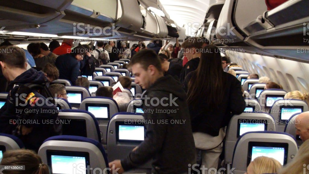 View Of Lufthansa Airlines Passengers Sitting Down, Standing, Looking...