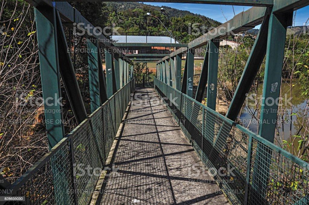 View of iron bridge over small river at Monte Alegre do Sul. stock photo