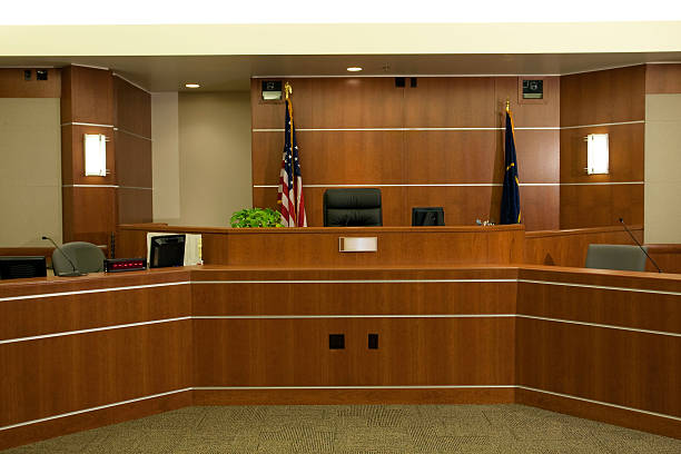 View of Judicial Bench in Modern Courtroom Setting Royalty free image showing a the judge's bench in a modern courtroom setting.  courtroom stock pictures, royalty-free photos & images