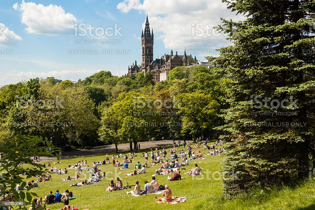 View of Kelvingrove Park with people and the Glasgow University stock photo