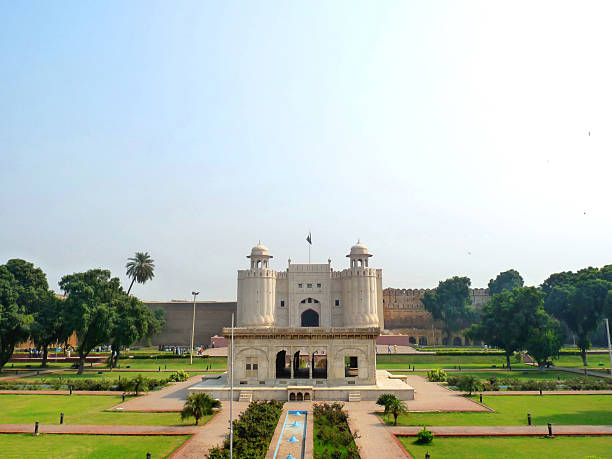 View of Lahore Fort and green fields Exterior View of Lahore Fort (Shahi Qilla) with small garden in foreground. Lahore Fort is located opposite to Badshahi Mosque in Lahore and is one of the most visited tourist destination. lahore pakistan stock pictures, royalty-free photos & images