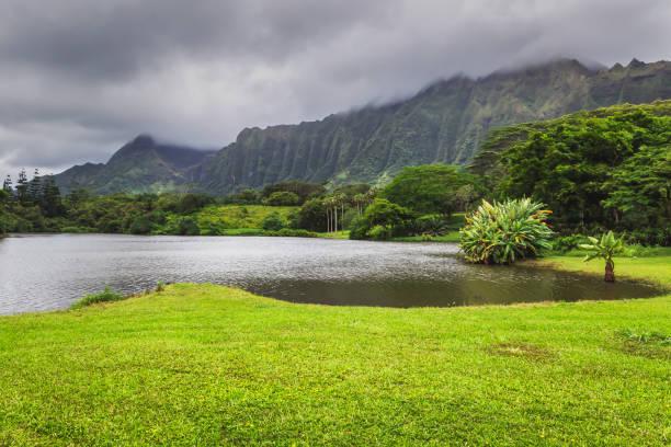 View of lake and mountains in Hoomaluhia botanical garden, Oahu island, Hawaii stock photo