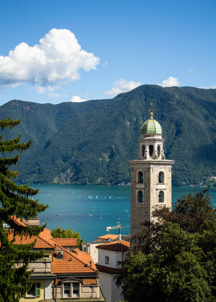 View of Lake Lugano & Cathedral of Saint Lawrence in Lugano, Switzerland stock photo
