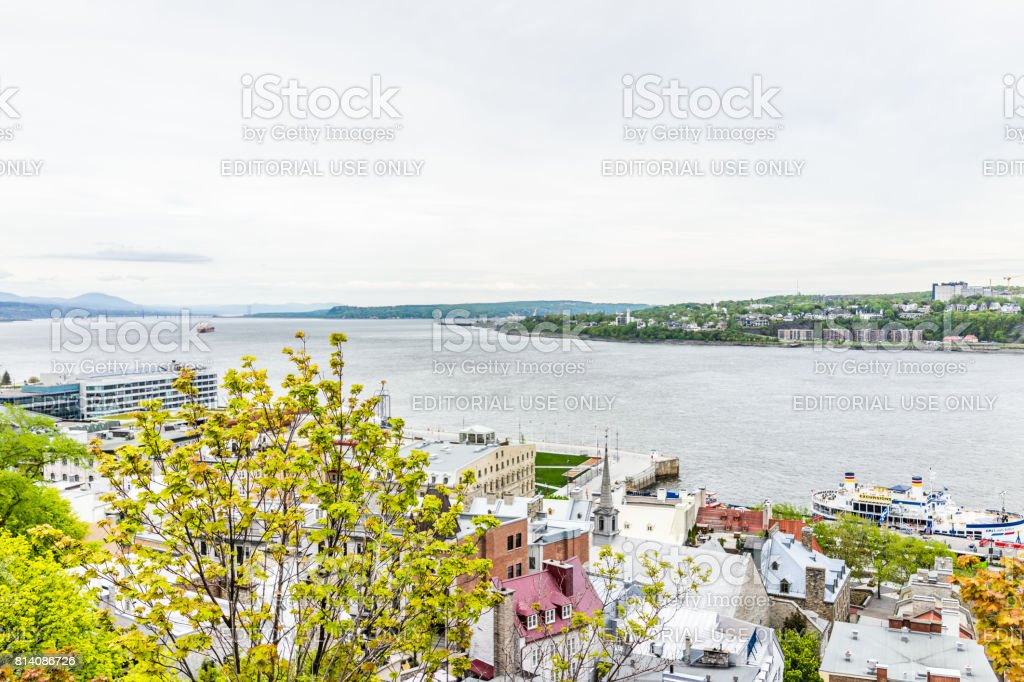 View of Levis town and Ile D'Orleans with St Lawrence river and old town rooftop buildings and ferry stock photo