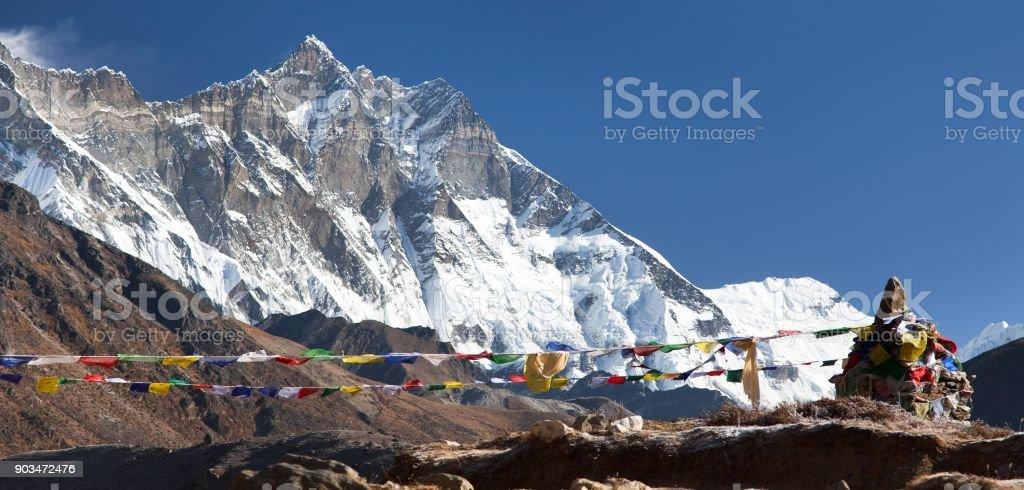 view of Lhotse peak with buddhist prayer flags stock photo