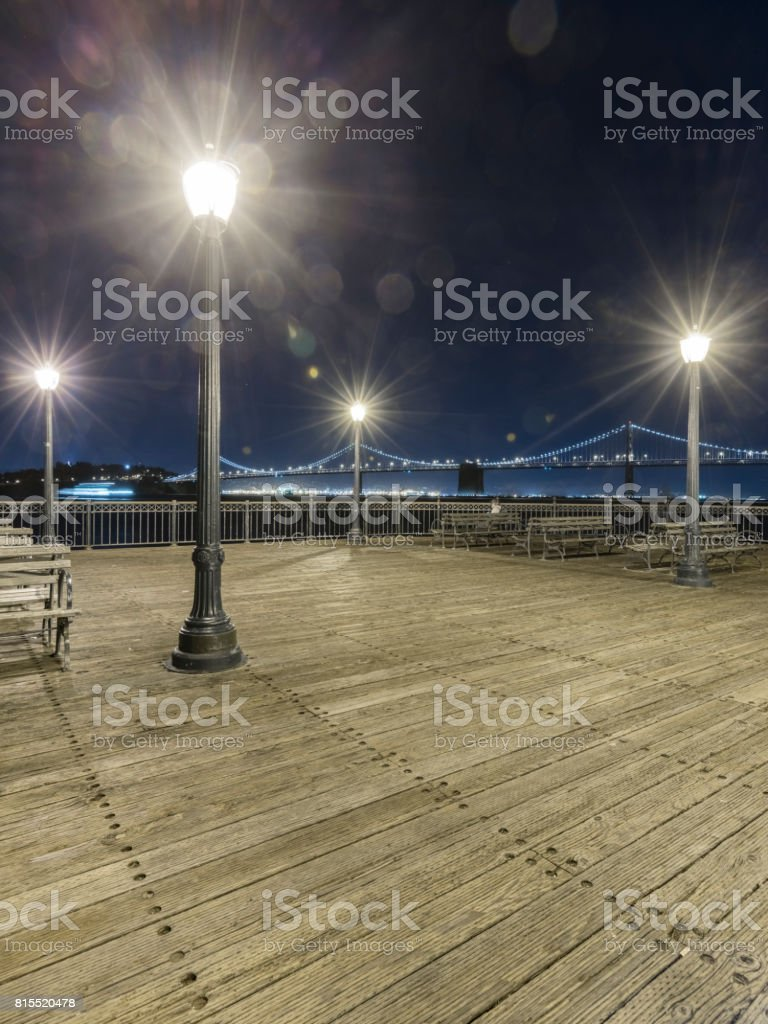 View Of Lights On Pier Seven Against Sky stock photo