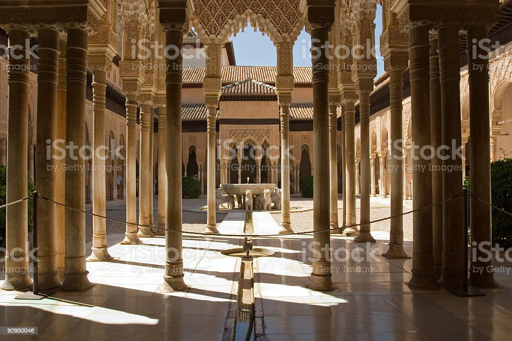 View of Lion's Patio in Alhambra with sun shining in stock photo