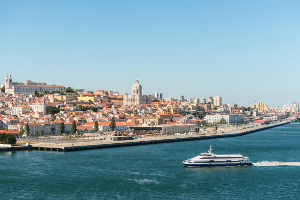 view of lisbon with the river tagus in portugal - lisbona foto e immagini stock
