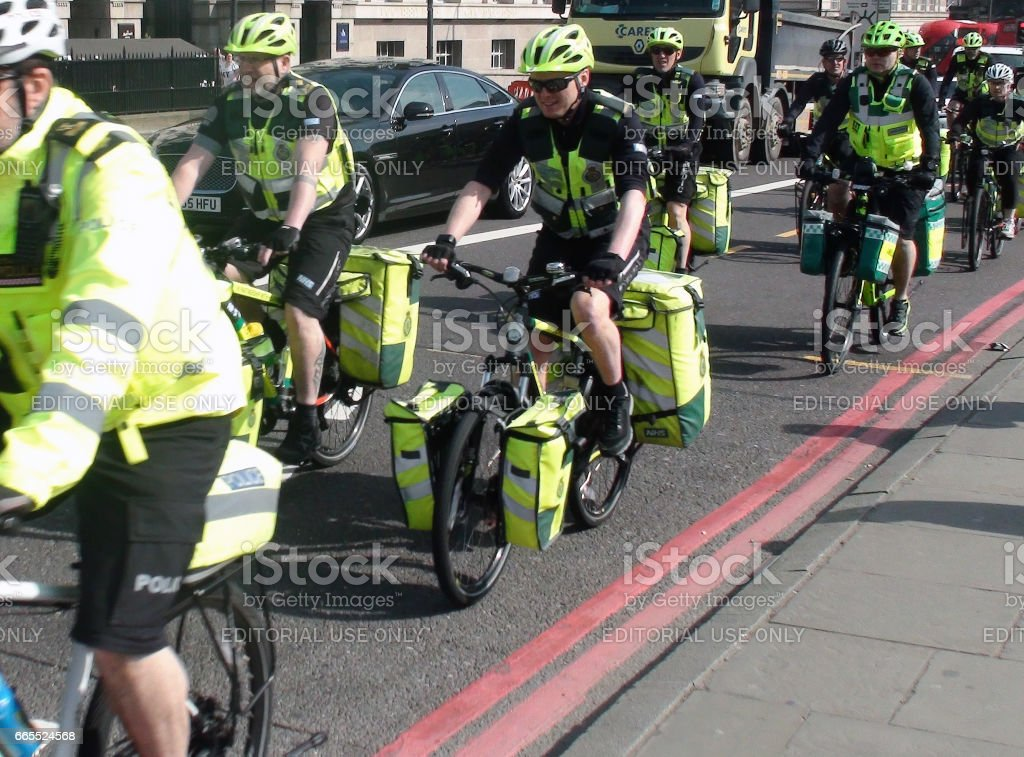 View Of London Ambulance Paramedics Crews On The Road With Bicycle In London stock photo
