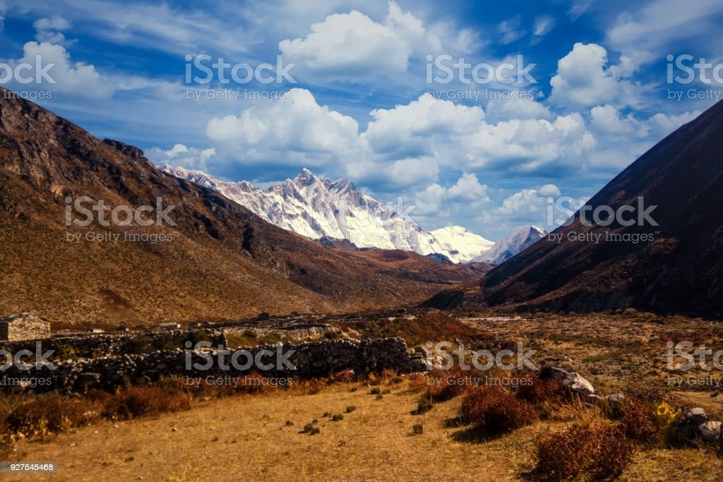 View of Lothse and Island Peak from Dingboche, Everest Region, Nepal stock photo