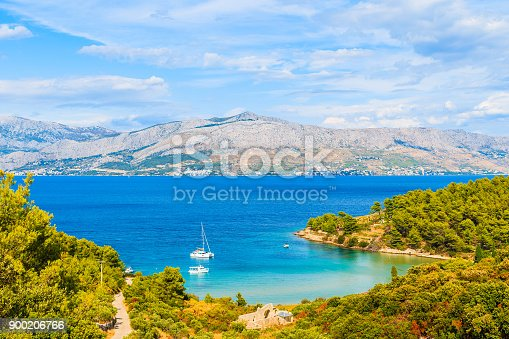 istock View of Lovrecina bay with sailing boats on blue sea, Brac island, Croatia 900206766