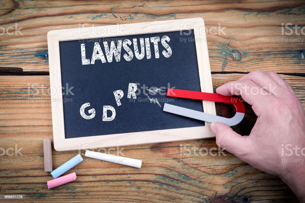 View of magnet attracting GDPR and lawsuits stock photo