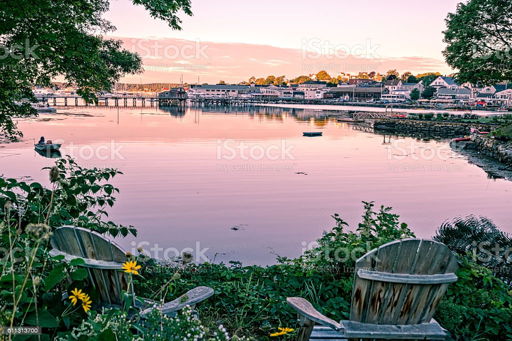 View of Maine harbor from garden chairs stock photo